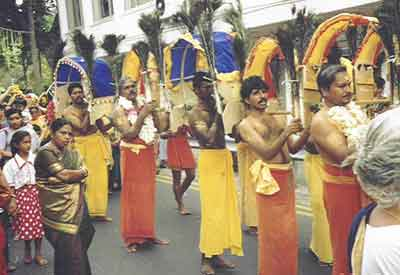 Male devotees carry Pal Kavadi in the annual Kavadi procession